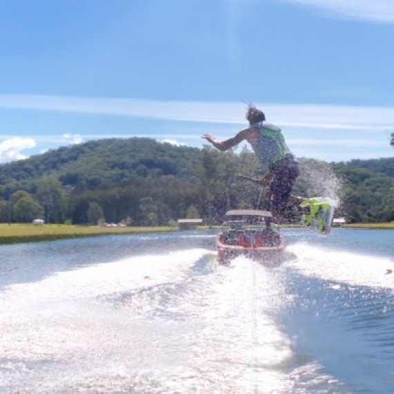 Brett Hodgkins teaching wakeboarding for OffAxis